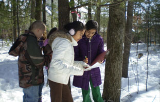 Students at an outdoor classroom in winter