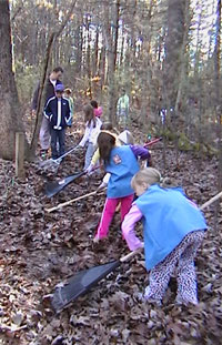 Brownies help with trail cleanup- Photo by Gaynor Bigelbach