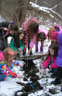 Girl Scouts learn about water quality during a trail cleanup - Photo by Gaynor Bigelbach